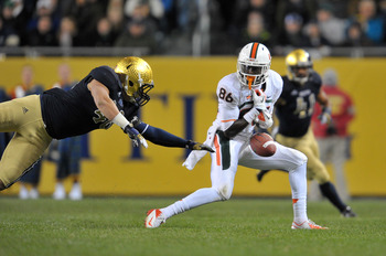 Oct. 6, 2012; Chicago, IL, USA; Miami Hurricanes wide receiver Herb Waters (86) attempts to catch a pass as Notre Dame Fighting Irish linebacker Dan Fox (48) defends in the third quarter at Soldier Field. Notre Dame won 41-3. Mandatory Credit: Matt Cashor