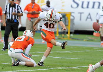 April 14, 2012; Miami Gardens, FL, USA; Miami Hurricanes kicker Jake Wieclaw (40) attempts a field goal at the end of the first half of the Miami Hurricanes spring game at Sun Life Stadium. Mandatory Credit: Brad Barr-US PRESSWIRE