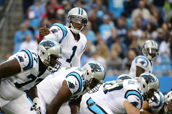 Oct 7, 2012; Charlotte, NC, USA; Carolina Panthers quarterback Cam Newton (1) at the line during the first half at Bank of America Stadium.  Mandatory Credit: Bob Donnan-US PRESSWIRE