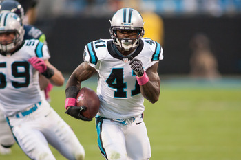 Oct 7, 2012; Charlotte, NC, USA; Carolina Panthers cornerback Captain Munnerlyn (41) returns an interception for a touchdown during the third quarter against the Seattle Seahawks at Bank of America Stadium. Mandatory Credit: Jeremy Brevard-US PRESSWIRE