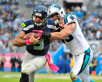 CHARLOTTE, NC - OCTOBER 07:  Luke Kuechly #59 of the Carolina Panthers forces Russell Wilson #3 of the Seattle Seahawks out-of-bounds during play at Bank of America Stadium on October 7, 2012 in Charlotte, North Carolina.  (Photo by Grant Halverson/Getty