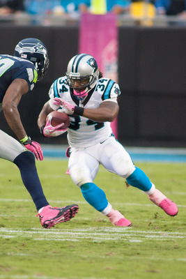 Oct 7, 2012; Charlotte, NC, USA; Carolina Panthers running back DeAngelo Williams (34) runs the ball against the Seattle Seahawks during the third quarter at Bank of America Stadium. The Seahawks defeated the Panthers 16-12. Mandatory Credit: Jeremy Breva