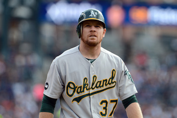 Brandon Moss tries to figure out where he went wrong after an at-bat.