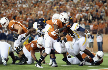 AUSTIN, TX - OCTOBER 06:  Joe Bergeron #24 of the Texas Longhorns runs for a touchdown against the West Virginia Mountaineers at Darrell K Royal-Texas Memorial Stadium on October 6, 2012 in Austin, Texas.  (Photo by Ronald Martinez/Getty Images)