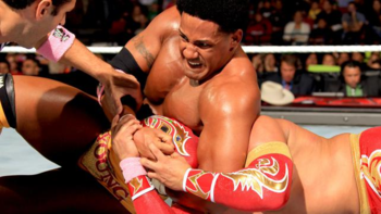 Darren Young takes down Sin Cara. (Photo Credit: WWE.com)