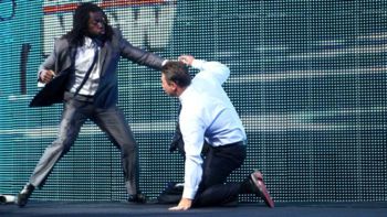 Kofi Kingston defends Larry King against The Miz. (Photo Credit: WWE.com)