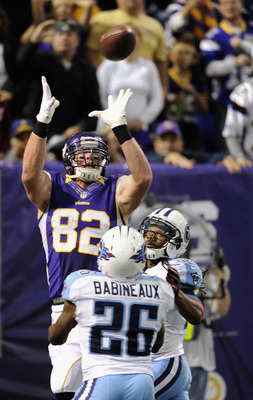 MINNEAPOLIS, MN - OCTOBER 7: Kyle Rudolph #82 of the Minnesota Vikings makes a catch for a touchdown over Jordan Babineaux #26 and Michael Griffin #33 of the Tennessee Titans during the third quarter of the game on October 7, 2012 at Mall of America Field