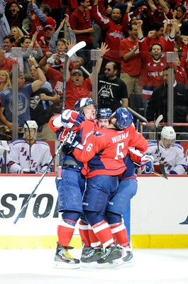 Ovechkin celebrating with his teammates.