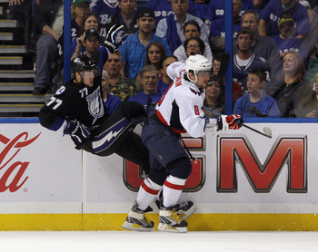 Ovechkin lays a hit on an unsuspecting Bolts skater.