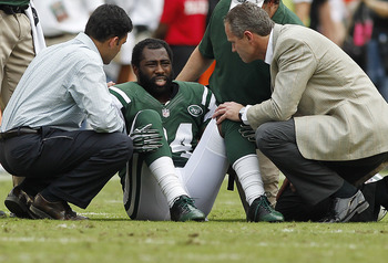 Sept 23, 2012; Miami Gardens, FL, USA;  New York Jets cornerback Darrelle Revis (24) is  attended to after being injured in the second half in a game against the Miami Dolphins at Sun Life Stadium. Mandatory Credit: Robert Mayer-US PRESSWIRE