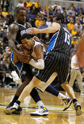 Glen Davis and Hedo Turkoglu fight Danny Granger for a loose ball in last season's playoffs