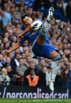 LONDON, ENGLAND - OCTOBER 06:  John Terry of Chelsea attempts against the Norwich City overhead kick during the Barclays Premier League match between Chelsea and Norwich City at Stamford Bridge on October 6, 2012 in London, England.  (Photo by Mike Hewitt