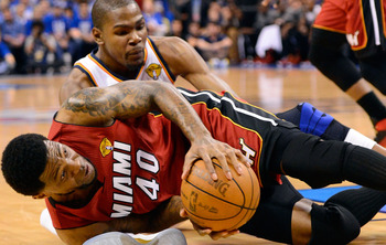 Udonis Haslem and Kevin Durant dive for the ball in the 2012 NBA finals.
