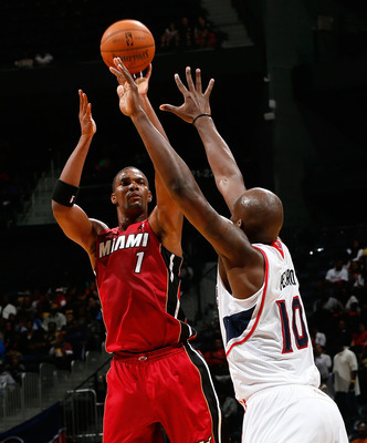 Chris Bosh shoots over Atlanta's Johan Petro in the Heat's first preseason game of the 2012-13 season.