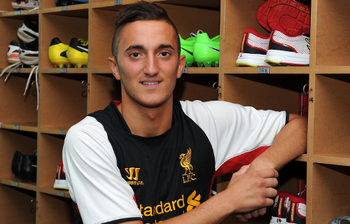 Photo from http://www.liverpoolfc.com/news/latest-news/reds-sign-youth-striker