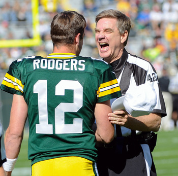 Aaron Rodgers sharing a laugh with a regular official.