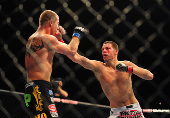 Dec 30, 2011; Las Vegas, NV, USA; UFC fighter Nate Diaz (right) against Donald Cerrone during a lightweight bout at UFC 141 at the MGM Grand Garden event center. Mandatory Credit: Mark J. Rebilas-US PRESSWIRE