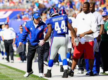 Coughlin and Bradshaw in a game against the Bills last year.