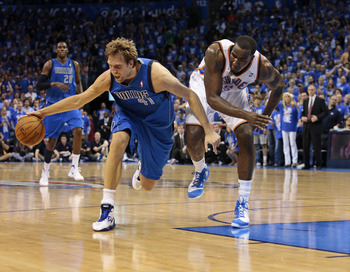 Dirk Nowitzki battles for control of the ball against the Thunder