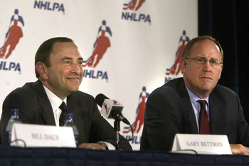 Gary Bettman and Bob Goodenow in July 2005 when the new CBA was ratified.