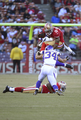 Kyle Williams goes airborne against the Vikings.