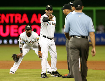 Miami Marlins manager Ozzie Guillen argues with umpires.