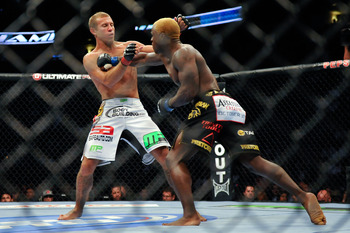 August 11, 2012; Denver, CO, USA; Donald Cerrone (left) fights Melvin Guillard (right) during UFC 150 at the Pepsi Center. Mandatory Credit: Ron Chenoy-US PRESSWIRE