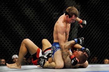Apr 21, 2012; Atlanta, GA, USA; Rory MacDonald (top) fights Chad Mills in a welterweight bout during UFC 145 at Philips Arena. Mandatory Credit: Paul Abell-US PRESSWIRE