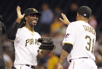 Andrew McCutchen congratulates teammate Jose Tabata during an Oct. 2 against the Atlanta Braves