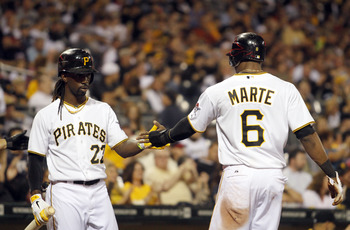 Andrew McCutchen acknowledges Starling Marte during an Oct. 2 matchup against the Atlanta Braves
