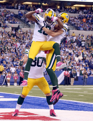 The Green Bay Packers celebrate after scoring a touchdown Sunday against the Indianapolis Colts.