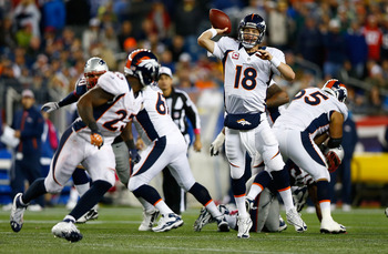Peyton Manning throws against the New England Patriots Sunday