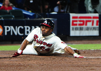 ATLANTA, GA - SEPTEMBER 16: Michael Bourn #24 of the Atlanta Braves scores a seventh inning run against the Washington Nationals at Turner Field on September 16 2012 in Atlanta, Georgia. (Photo by Scott Cunningham/Getty Images)
