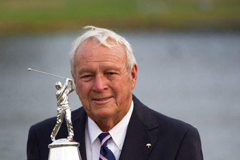 Arnold Palmer with the trophy that goes to the winner of his tournament.