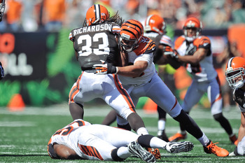 CINCINNATI, OH - SEPTEMBER 16:  Jamaal Anderson #92 of the Cincinnati Bengals tackles Trent Richardson #33 of the Cleveland Browns at Paul Brown Stadium on September 16, 2012 in Cincinnati, Ohio.  (Photo by Jamie Sabau/Getty Images)