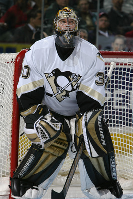 OTTAWA - JANUARY 22:  Goalie Jean-Sebastien Aubin #30 of the Pittsburgh Penguins protects the net from the Ottawa Senators during the game at Corel Centre on January 22, 2004 in Ottawa, Ontario. The Senators defeated the Penguins 6-5. (Photo By Dave Sandf
