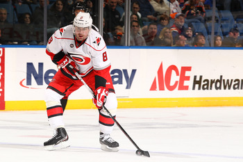UNIONDALE, NY - FEBRUARY 18: Jaroslav Spacek #8 of the Carolina Hurricanes  in action against the New York Islanders during their game on February 18, 2012 at the Nassau Coliseum in Uniondale, New York.  (Photo by Al Bello/Getty Images)