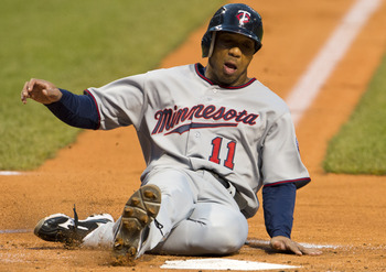 CLEVELAND, OH - SEPTEMBER 18: Ben Revere #11 scores on a sacrifice fly hit by Justin Morneau #33 of the Minnesota Twins during the first inning against the Cleveland Indians at Progressive Field on September 18, 2012 in Cleveland, Ohio. (Photo by Jason Mi