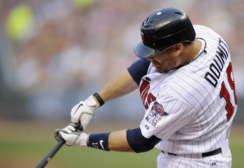 MINNEAPOLIS, MN - JUNE 29: Ryan Doumit #18 of the Minnesota Twins hits an RBI single against the Kansas City Royals during the second inning on June 29, 2012 at Target Field in Minneapolis, Minnesota. (Photo by Hannah Foslien/Getty Images)
