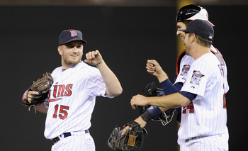 MINNEAPOLIS, MN - SEPTEMBER 28: (L-R) Glen Perkins #15, Joe Mauer #7 and Trevor Plouffe #24 of the Minnesota Twins celebrate a win of the game against the Detroit Tigers on September 28, 2012 at Target Field in Minneapolis, Minnesota. (Photo by Hannah Fos