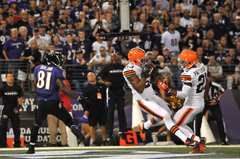 Craig Robertson (center) notches his second interception of the season in Week 4 at Baltimore.