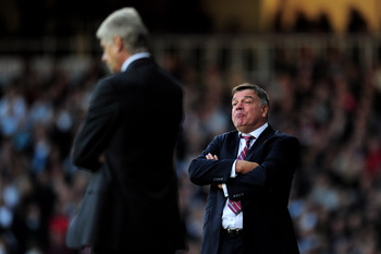 LONDON, ENGLAND - OCTOBER 06:  Sam Allardyce the manager of West Ham reacts as Arsene Wenger the Arsenal manager looks on during the Barclays Premier League match between West Ham United and Arsenal at the Boleyn Ground on October 6, 2012 in London, Engla