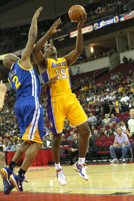 Jarrett Jack plays defense on Metta World Peace in Golden State's Oct. 7 preseason game vs. the Lakers.