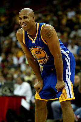 Richard Jefferson smiles in Warriors' preseason game against the Los Angeles Lakers.
