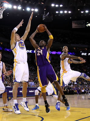 Andris Biedrins guards Kobe Bryant in the Warriors' January game against the Lakers.