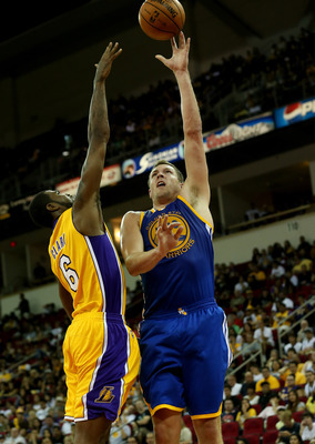 David Lee shoots over Lakers' Earl Clark in an October preseason game.