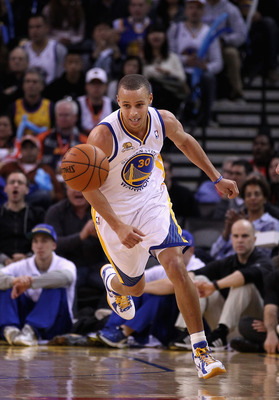 Stephen Curry chases the ball in Golden State's February game against Portland.