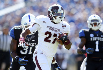 LEXINGTON, KY - OCTOBER 06:  LaDarius Perkins #27 of the Mississippi State Bulldogs runs for a touchdown during the SEC game against the Kentucky at Commonwealth Stadium on October 6, 2012 in Lexington, Kentucky.  (Photo by Andy Lyons/Getty Images)