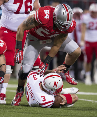 October 6, 2012; Columbus, OH, USA; Ohio State Buckeyes defensive lineman John Simon (54) sacks Nebraska Cornhuskers quarterback Taylor Martinez (3) at Ohio Stadium.  Mandatory Credit: Greg Bartram-US PRESSWIRE