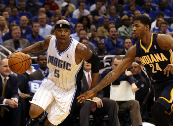 Quentin Richardson drives past Paul George in last season's playoffs.
